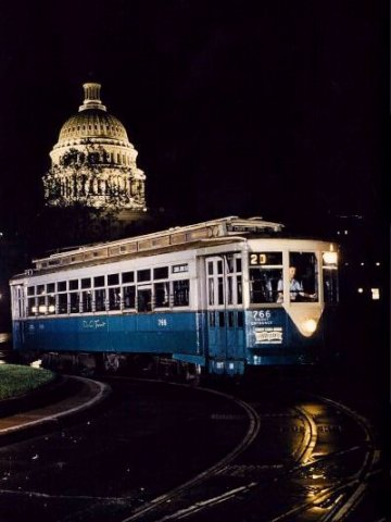 DC Transit 766 at night with the Capitol in the background